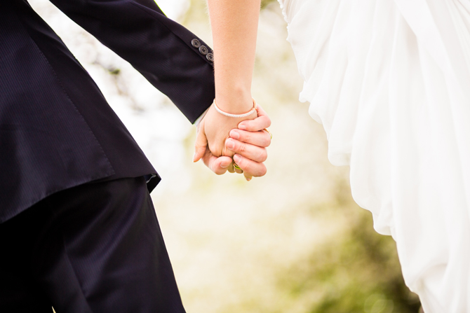 Bride and groom walking together and holding hands